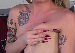 Tatted TS Athena Addams smokin' in front exclusively jerk missing off